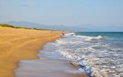 Running along the beach. Running along the beautiful sandy Kaiafas beach, Greece royalty free stock image
