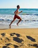 Running along the beach. Running along the beautiful sandy Kaiafas beach, Greece stock image