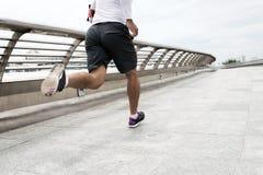 Running along the bridge Stock Images