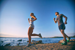Running along coastline Stock Images