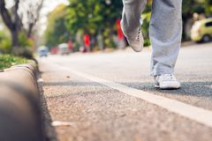 Running along the road Royalty Free Stock Image