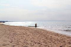 Running along the sea. Sports and nature, running along the sea Stock Photography