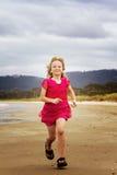 Running along shore Royalty Free Stock Image