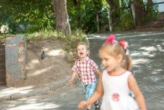 Running around children. Boy and girl running around Stock Images