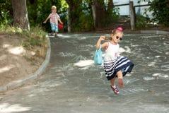 Running around children. Boy and girl running around Royalty Free Stock Photography