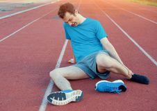 Running athlete feeling pain because of injured ankle Stock Photography