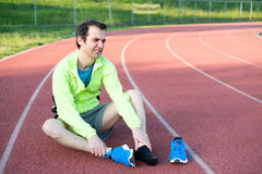 Running athlete feeling pain because of injured ankle Royalty Free Stock Photos
