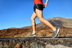 Running athlete man runner jogging on nature road Stock Image