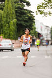 Running athlete in mini-marathon race Royalty Free Stock Images