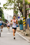 Running athlete in mini-marathon race Royalty Free Stock Photography