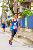 Running athlete in mini-marathon race Stock Images