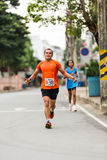 Running athlete in mini-marathon race Stock Image