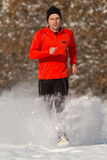 Running athlete in the snow. Athlete running in the snow Stock Photo