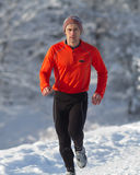 Running athlete in the snow. Athlete running in the snow Royalty Free Stock Photography