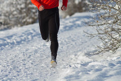 Running athlete in the snow. Athlete running in the snow Royalty Free Stock Image