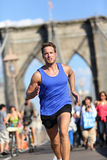 Running athlete training on Brooklyn bridge, NYC. Running athlete training cardio on Brooklyn bridge, New York City, NYC. Male caucasian runner running. Young royalty free stock photography