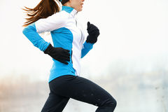Running athlete in winter Royalty Free Stock Image