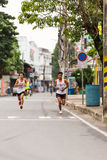 Running athletes in mini-marathon race Stock Photo