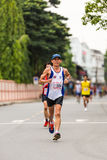 Running athletes in mini-marathon race Stock Image