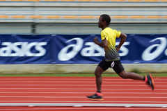 Running athletes at stadium in Skoda relay race athletics competition stock image