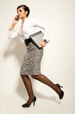 Running atractive brunet businesswoman Stock Photography