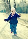 Running baby in cap. Royalty Free Stock Images