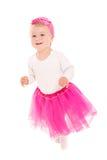 Running baby girl in pink tutu Royalty Free Stock Photo