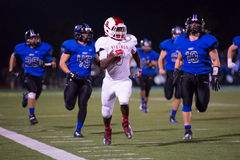 Friday Night Lights High School Football Running back outrunning defensive team Stock Photo