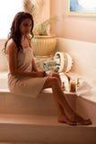 Running a bath. Attractive woman runs a hot bath stock image