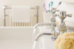 Running bathroom sink royalty free stock photos