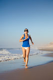 Running on the beach Royalty Free Stock Photo