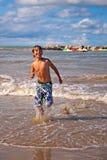 Running on the beach Stock Photography
