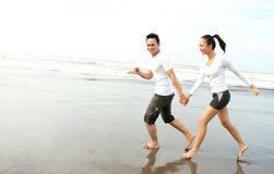 Running on the beach Stock Photography