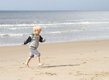 Running on the beach Royalty Free Stock Photos