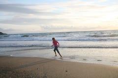 Running on the beach stock photos