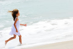 Running on the beach Stock Images