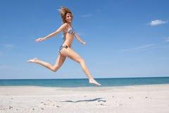 Running on the beach Stock Image