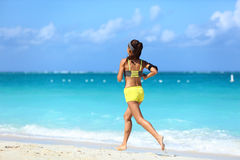 Running on beach - summer workout active lifestyle stock photo