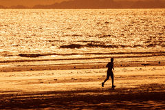 Running on the beach at sunset Royalty Free Stock Photography