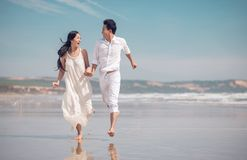 Running on beach. Vietnamese couple in love running on beach Royalty Free Stock Images