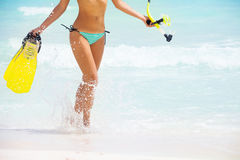 Running beautiful girls body on beach background Stock Image