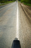 Running bicycle. Bicycle running along the road Royalty Free Stock Photos