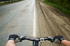 Running bicycle. Bicycle running along the road Royalty Free Stock Photo