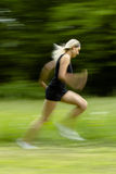 Running blond woman in black Royalty Free Stock Photos
