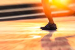 The running blure background and motion blure backgroud. the man ware sport shoe. stock images