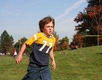 Running Boy. Young boy out of breath from running Stock Image