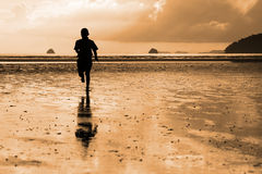 Running boy on the beach Royalty Free Stock Images
