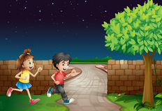 A running boy and a girl are. Illustration of a running boy and a girl in a dark night Stock Photo