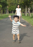 Running boy. Happy running asia boy in park Stock Images