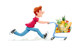 Running boy with product cart. Shopping in supermarket. Royalty Free Stock Photos